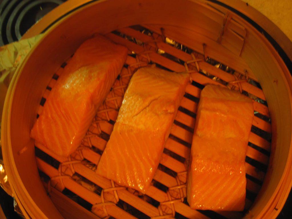 Salmon in steamer skin side down